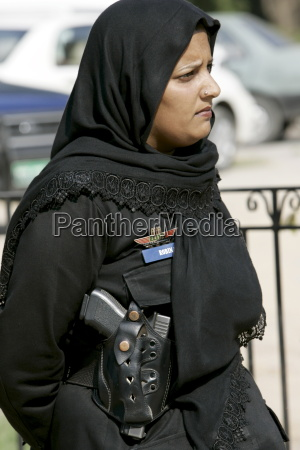 female armed police officer with hijab