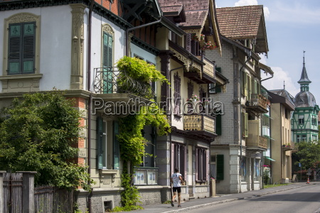 jogger passes traditional houses in neugasse