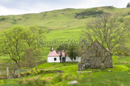 quaint cottage dwelling and old stone