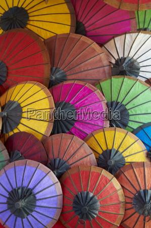 handmade paper umbrellas in the night