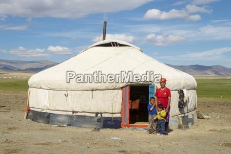 nomadic kazakh family and their yurt