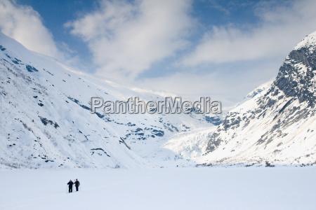 nordic skiing through a glacial valley