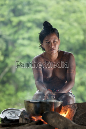 embera woman cooks rice in a