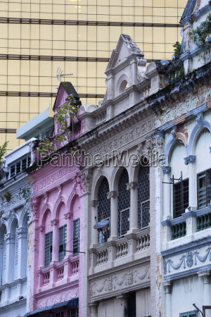 colonial era architecture with glass office