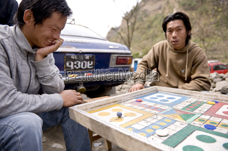 gentlemen playing ludo naya pul annapruna
