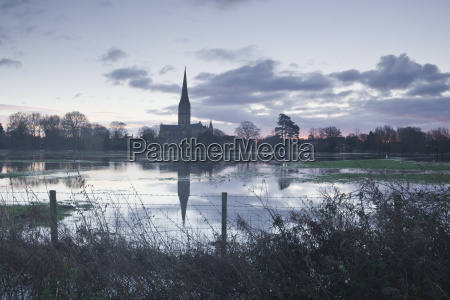 salisbury cathedral at dawn reflected in