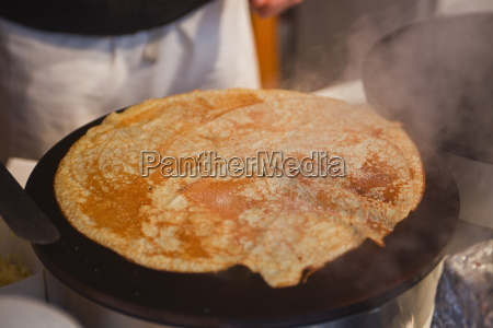 a crepe being prepared at a