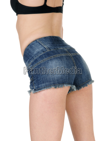 back of woman in jeans shorts