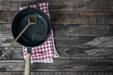 black frying pan with a wooden