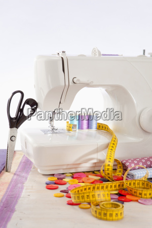 sewing machine with many sewing utensils