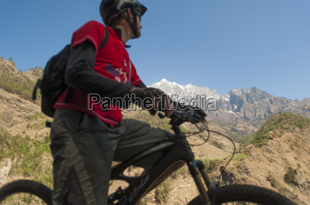 a mountain biker in the tsum