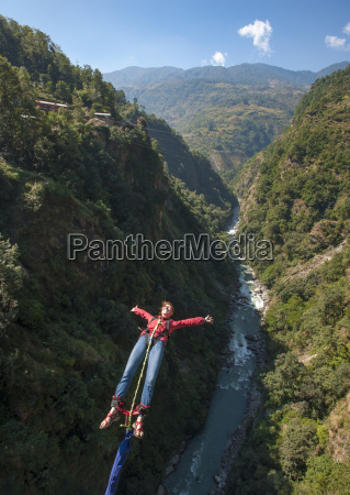 a girl jumps a bungy backwards