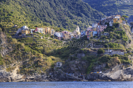 colourful houses and cliffs atop rocky