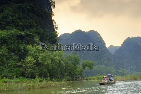 boats in the karst landscapes of