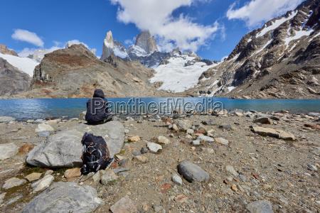 a lone figure in mountain gear