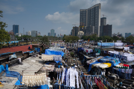 slum washing ghats surrounded by expensive