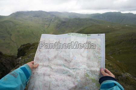 a woman checks her map while
