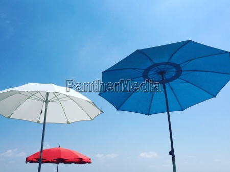 red white and blue beach parasols