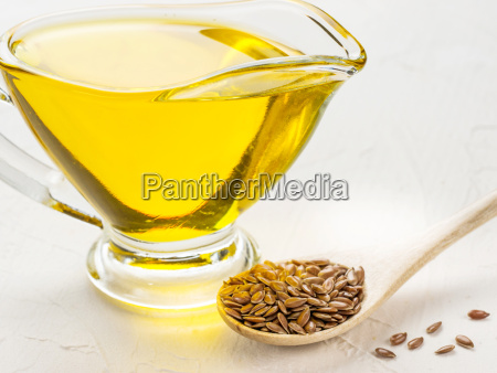 brown flax seeds in spoon and