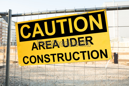caution sign on the construction site