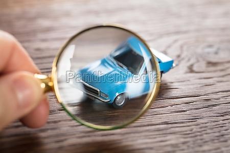 person scrutinizing a car model