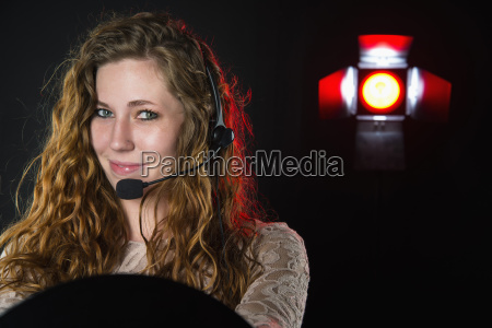 young woman with headset smiling close