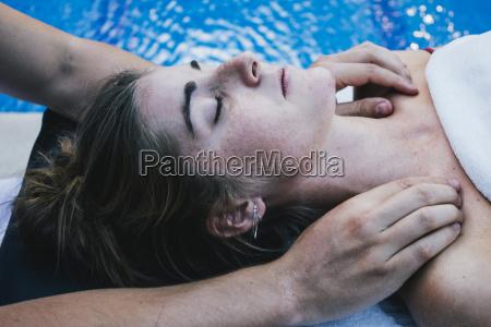 physiotherapist massaging patients collarbones