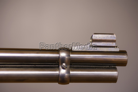 gun barrel against brown background close