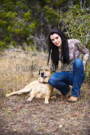 young woman with blackmouth dog in