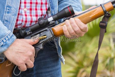texas cowboy loading ammunition in hunting