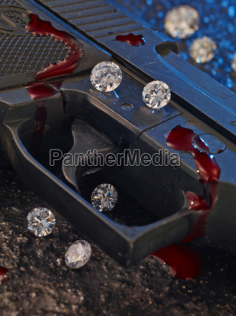 trigger of pistol with diamonds and