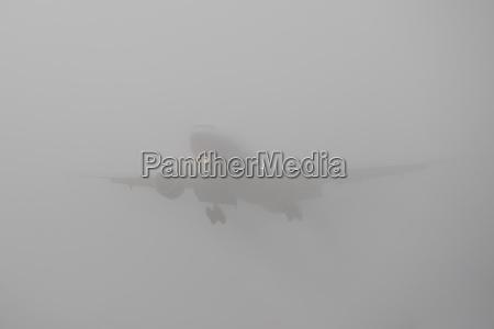 germany hesse frankfurt landing airplane in