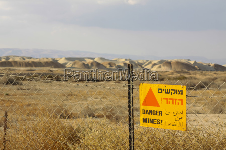israel view of minefield with sign