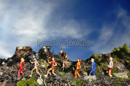 figurines of joggers running through landscape