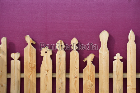 wooden fence with carvings