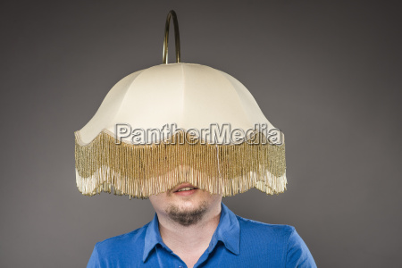 mid adult man with electric lamp