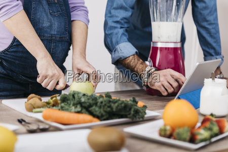 hands of couple preparing fruits and