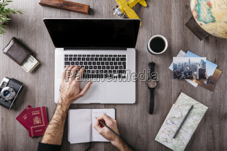 overhead view of man using laptop