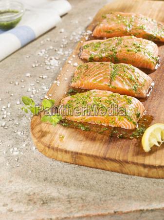 marinated salmon on chopping board