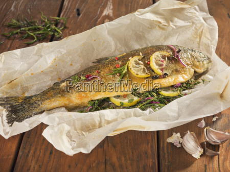 fried trout stuffed with herbs on