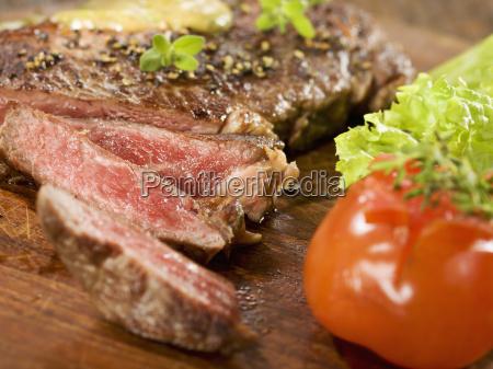 grilled rib eye steak with herb