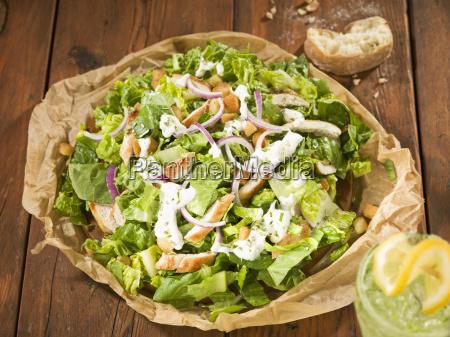 caesar salad with cool drink close