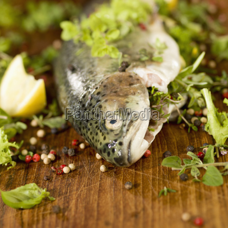 trout stuffed with herbs on wood