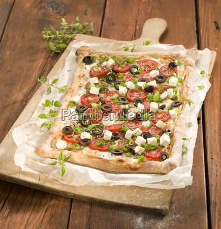 tarte with tomato slice and feta