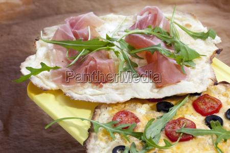 tartes with serrano ham black olives