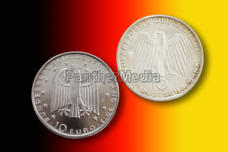 two german commemorative coins in front