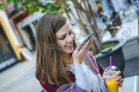young woman in sevilla drinking fruit