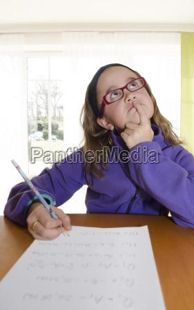 austria thinking schoolgirl doing homework