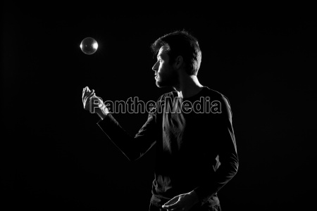 man juggling with crystal ball before