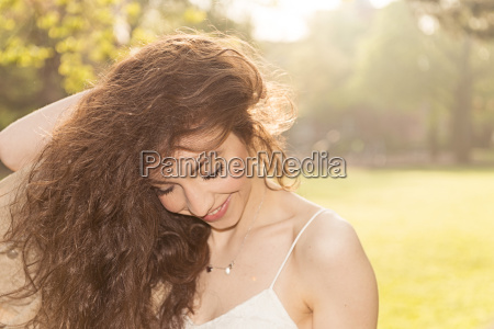 smiling young woman with hand in